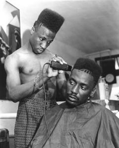 """""""Big Daddy Kane"""" getting his """"Fade"""" haircut all trimmed up. (Image courtesy of Fashion Bomb Daily)."""