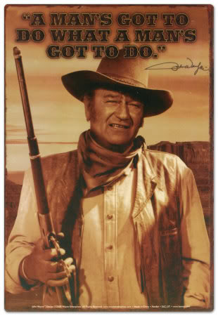 """John Wayne - one of the most famous of the old Wild West """"gun slingers."""""""