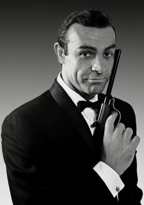 James Bond - sporting a classic tuxedo and handy firearm. -Image from Sean Connery Day