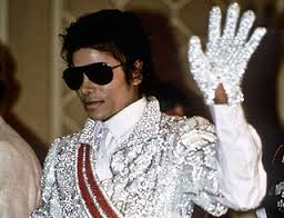 M.J. - all in white (to match his white glove, of course). -image from Hello Magazine