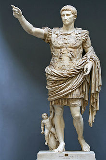 Here, Augustus Gaius Octavius, the first official Emperor of Rome, wears the coronation wreath (and, apparently, a small child).